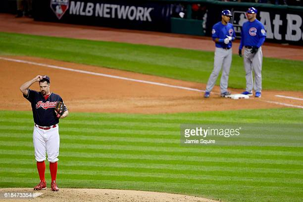 Bryan Shaw of the Cleveland Indians reacts on the pitcher's mound after walking Addison Russell of the Chicago Cubs and scoring Kyle Schwarber during...