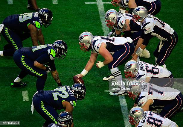 Bryan Stork of the New England Patriots prepares to snap the ball in the first quarter against the Seattle Seahawks during Super Bowl XLIX at...
