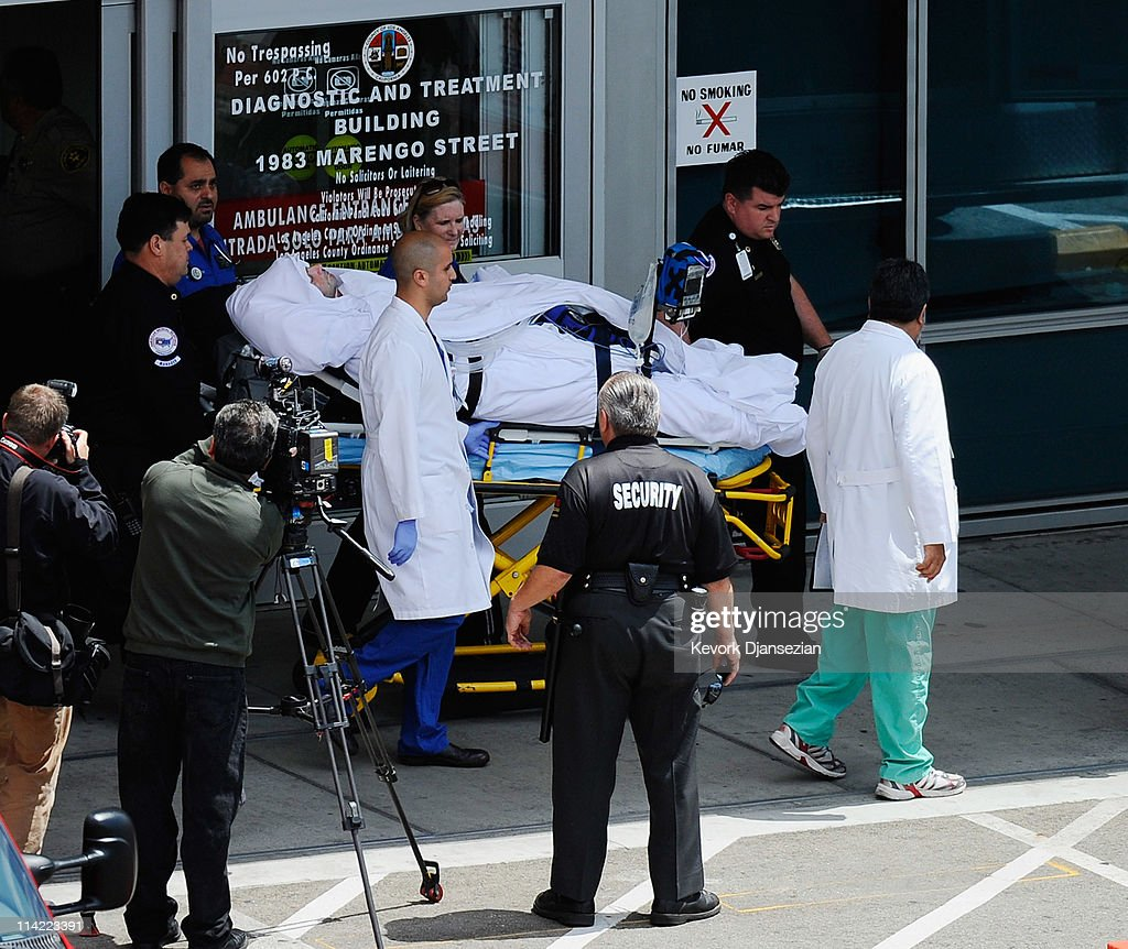 Bryan Stow, escorted by his neurosurgeon Dr. Gabriel Zada (C) and medical staff, is taken from Los Angeles County-USC Medical Center to Bob Hope Airport for a trip to San Francisco General Hospital, on May 16, 2011 in Los Angeles, California. Stow, from Santa Cruz, California, was beaten in the Los Angeles Dodgers parking lot after the opening day game against the San Francisco Giants almost six weeks ago.
