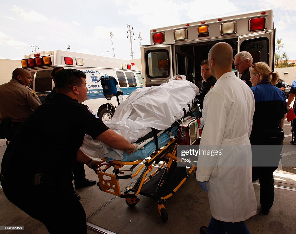 Bryan Stow is loaded into an ambulance, as his neurosurgeon Dr. Gabriel Zada (R) and the medical staff watch, so he can be taken from Los Angeles County-USC Medical Center to Bob Hope Airport for a trip to San Francisco General Hospital, on May 16, 2011 in Los Angeles, California. Stow, a San Francisco Giants fan from Santa Cruz, California, was beaten at the Los Angeles Dodgers parking lot after the opening day game against the San Francisco Giants almost six weeks ago.