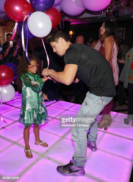 Bryan Tanaka and Mariah Carey's daughter Monroe attend the Mariah Carey concert after party at Sugar Factory American Brasserie on Ocean Drive on...