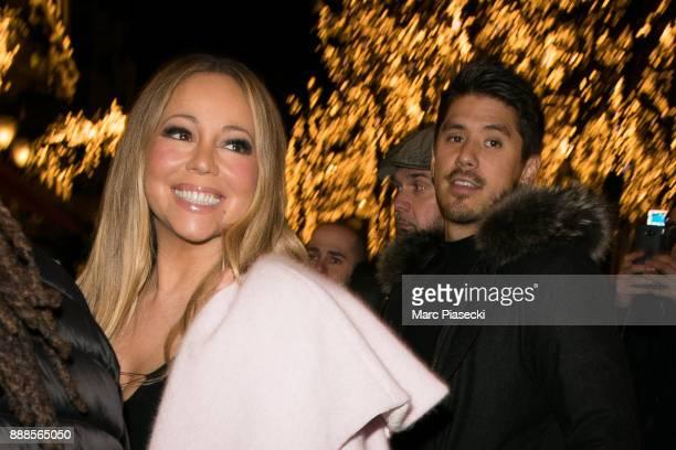 Bryan Tanaka and singer Mariah Carey are seen on December 8 2017 in Paris France