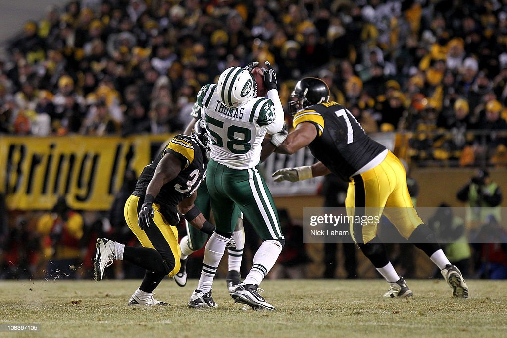 Bryan Thomas of the New York Jets intercepts a pass against the Pittsburgh Steelers during the 2011 AFC Championship game at Heinz Field on January...