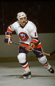 Bryan Trottier of the New York Islanders skates on the ice during an NHL game circa 1980's at the Nassau Coliseum in Uniondale New York