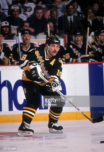 Bryan Trottier of the Pittsburgh Penguins passes the puck during an NHL game against the Philadelphia Flyers circa 1993 at the Spectrum in...