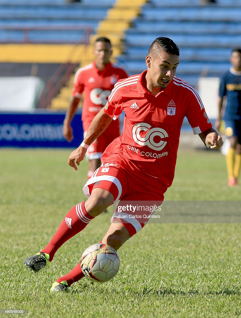 Bryan Urueña of America de Cali plays the ball during a match between America de Cali and Bogota FC as part of 17th round of Torneo Aguila 2015 at 12 de Octubre Stadium on July 12, 2015 in Tulua, Colombia.