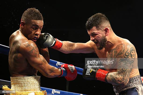 Bryan Vera punches Willie Monroe Jr during their NABA/NABO middleweight championship fight at the Turning Stone Resort Casino on January 16 2015 in...