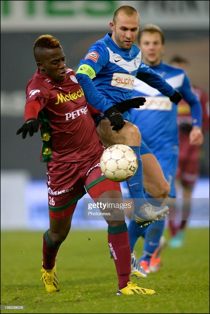 Bryan Verboom of Zulte-Waregem battles for the ball with Thomas Buffel of KRC Genk during the Cofidis Cup 1/4 final away match between SV Zulte Waregem and KRC Genk in the Regenboog stadium on December 13, 2012 in Waregem, Belgium.