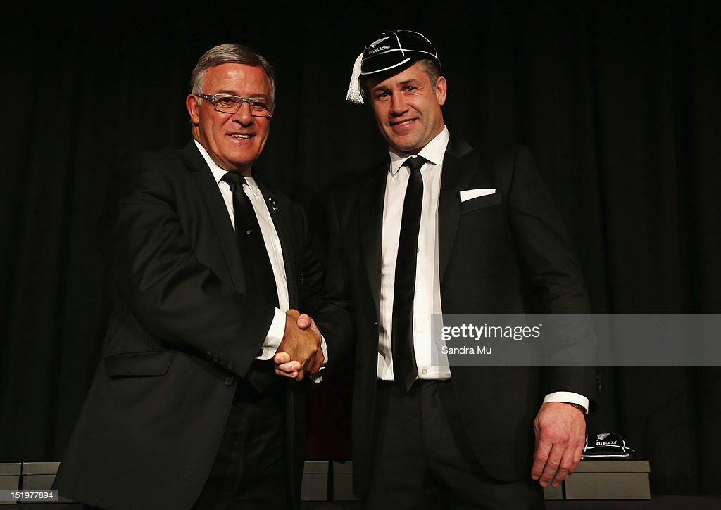 Bryan Williams, president of the New Zealand Rugby Union (L) caps former All Black Marc Ellis during the New Zealand All Blacks reunion dinner on September 14, 2012 in Dunedin, New Zealand.