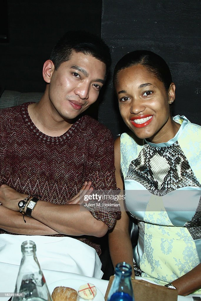 Bryanboy and Tamu McPherson attend the Glamour dinner for Patrick Demarchelier as part of the Paris Fashion Week Womenswear Spring/Summer 2014 at Monsieur Bleu restaurant on September 29, 2013 in Paris, France.