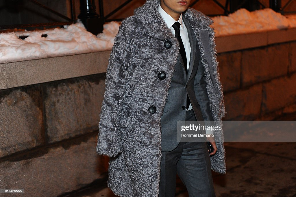 Bryanboy seen outside the Tommy Hilfiger show wearing Marc Jacobs coat, Bespoke suit, Armani necktie and Belstaff shoes on February 10, 2013 in New York City.