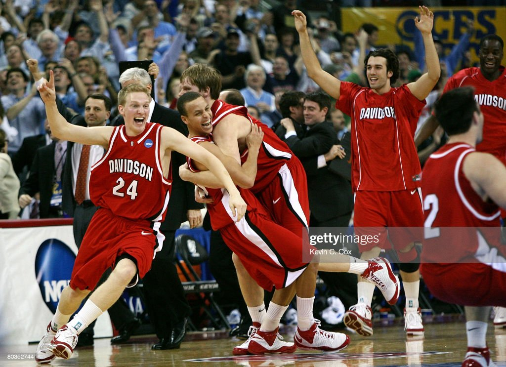 Bryant Barr #24, Stephen Curry #30 and Thomas Sander #15 of the Davidson Wildcats celebrate after defeating the Georgetown Hoyas 74-40 during the 2nd round of the 2008 NCAA Men's Basketball Tournament at RBC Center March 23, 2008 in Raleigh, North Carolina.
