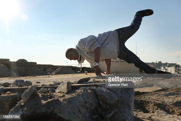 Bryant Blackshear practices 'parkour' a sport that embraces the urban landscape as an obstacle course on the remains of the boardwalk at Rockaway...