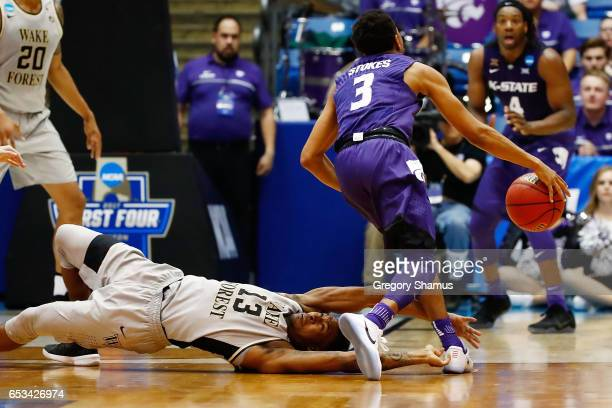Bryant Crawford of the Wake Forest Demon Deacons fouls Kamau Stokes of the Kansas State Wildcats in the second half during the First Four game in the...