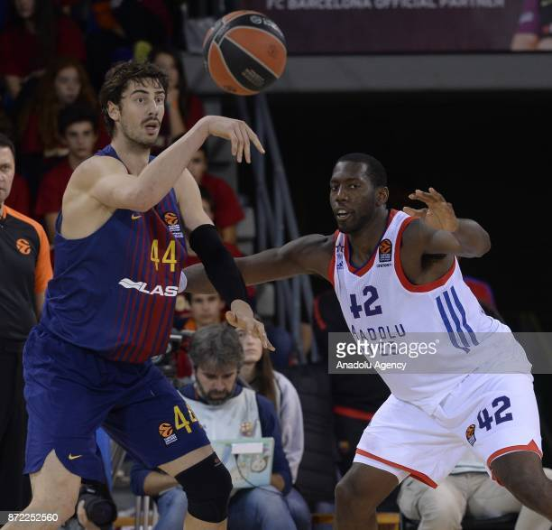 Bryant Dunston of Anadolu Efes in action against Ante Tomic of Barcelona during the Turkish Airlines Euroleague basketball match between Barcelona...