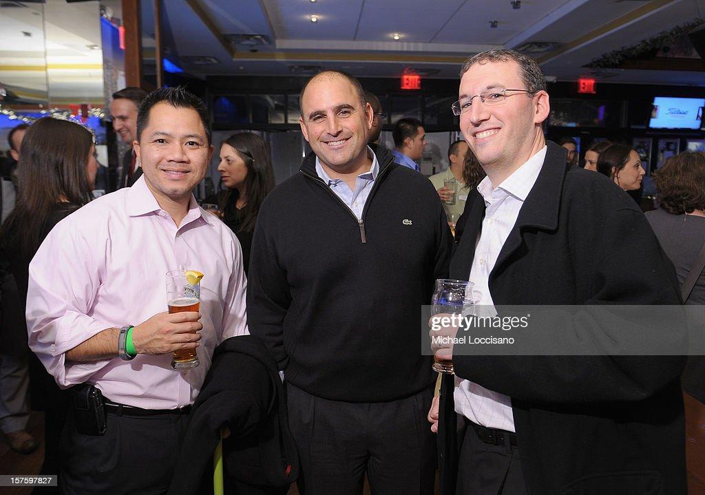 Bryant Ho, Brett Yarkon and Matt Klein attend the Hearing Health Foundation's Junior Board Holiday Fundraiser at Ashton's Alley on December 4, 2012 in New York City.