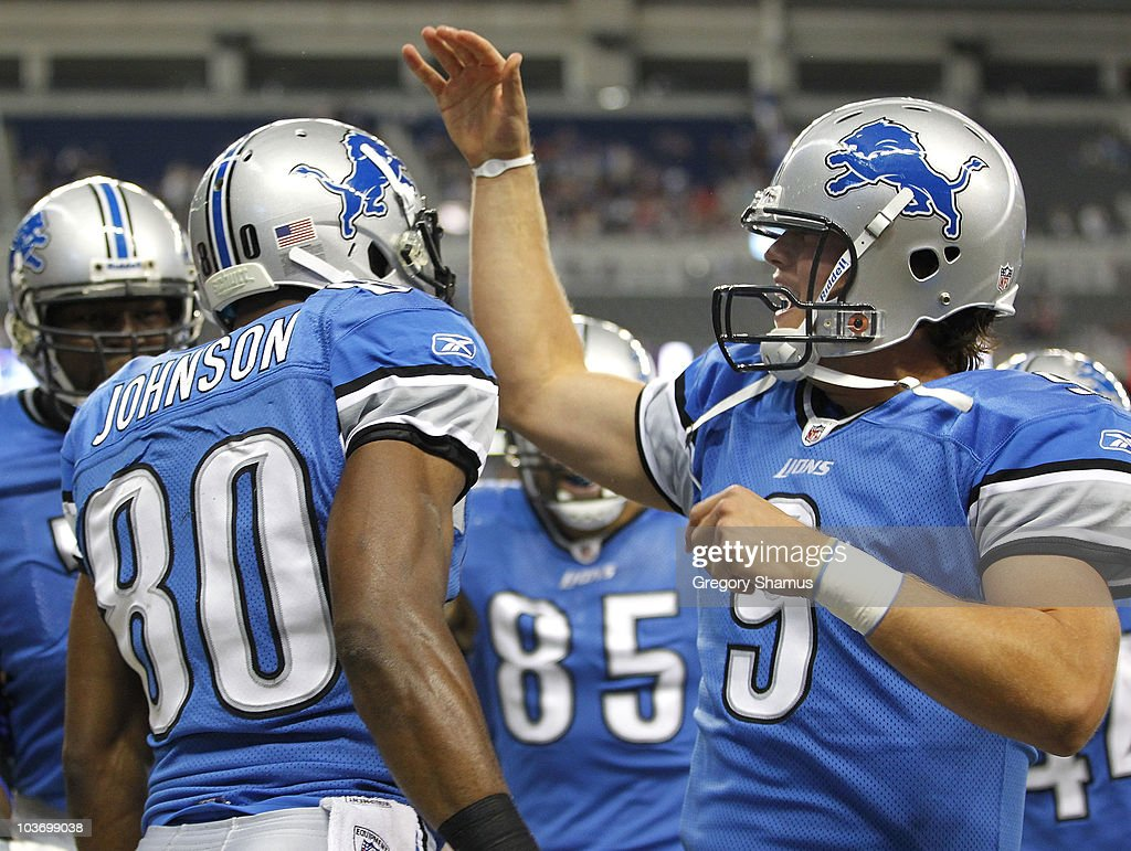 Bryant Johnson #80 of the Detroit Lions celebrates a first quarter touchdown with Matthew Stafford #9 of the Cleveland Browns during a preseason game on August 28, 2010 at Ford Field in Detroit, Michigan.