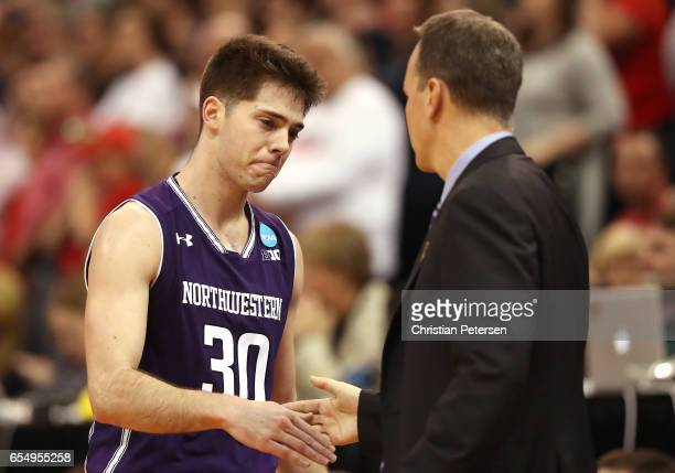 Bryant McIntosh and head coach Chris Collins of the Northwestern Wildcats shake hands as he is substituted out late in the game in their loss to the...