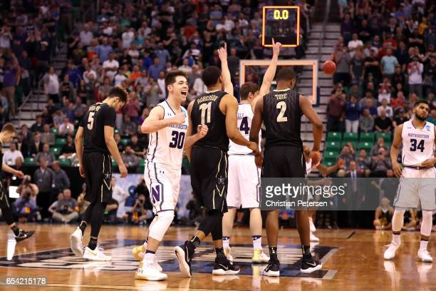Bryant McIntosh of the Northwestern Wildcats celebrates with teammates after defeating the Vanderbilt Commodores during the first round of the 2017...