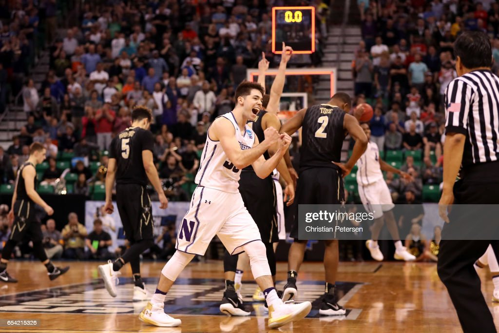 Bryant McIntosh #30 of the Northwestern Wildcats celebrates with teammates after defeating the Vanderbilt Commodores during the first round of the 2017 NCAA Men's Basketball Tournament at Vivint Smart Home Arena on March 16, 2017 in Salt Lake City, Utah.