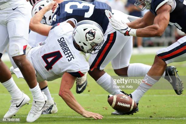 Bryant Shirreffs of the Connecticut Huskies loses a fumble during a game against the Virginia Cavaliers at Scott Stadium on September 16 2017 in...