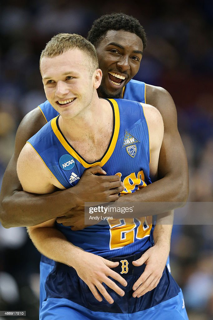 Bryce Alford #20 of the UCLA Bruins celebrates with Isaac Hamilton #10 after defeating Southern Methodist Mustangs during the second round of the 2015 NCAA Men's Basketball Tournamenat at the KFC YUM! Center on March 19, 2015 in Louisville, Kentucky.