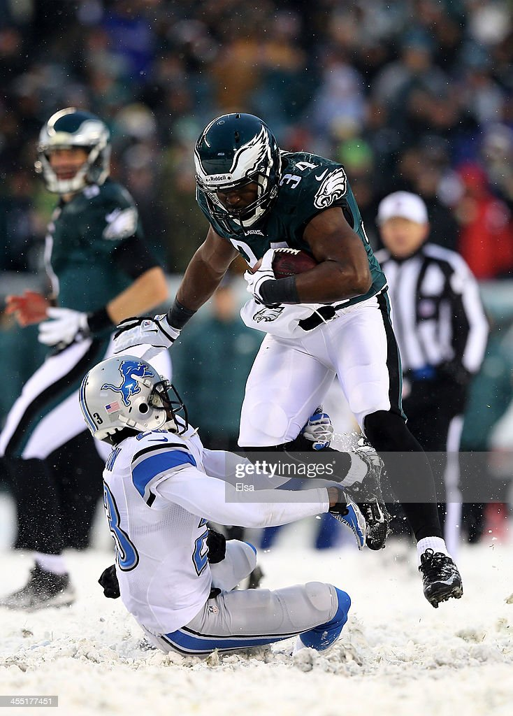 Bryce Brown #34 of the Philadelphia Eagles avoids getting tackled by Chris Houston #23 of the Detroit Lions on December 8, 2013 at Lincoln Financial Field in Philadelphia, Pennsylvania.The Philadelphia Eagles defeated the Detroit Lions 34-20.