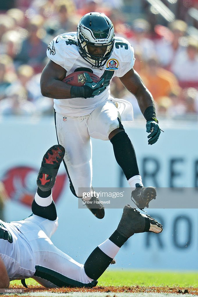 Bryce Brown #34 of the Philadelphia Eagles hurdles another player during the game against the Tampa Bay Buccaneers at Raymond James Stadium on December 9, 2012 in Tampa, Florida. The Eagles won 23-21.