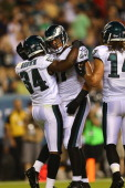 Bryce Brown of the Philadelphia Eagles is congratulated by Arrelious Benn after Brown scored a touchdown against the New England Patriots on August 9...