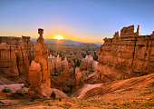 The sun rising above Thor's Hammer at Bryce Canyon National Park, Utah.