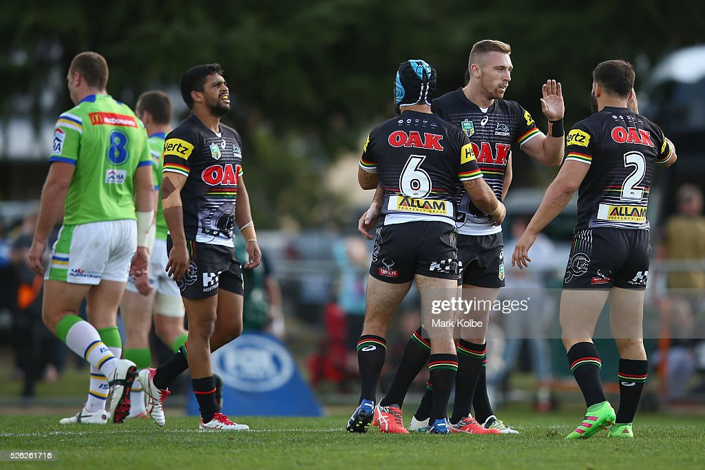 Bryce Cartwright of the Panthers celebrates with his team mates after scoring a try during the round nine NRL match between the Penrith Panthers and the Canberra Raiders at Carrington Park on April 30, 2016 in Bathurst, Australia.