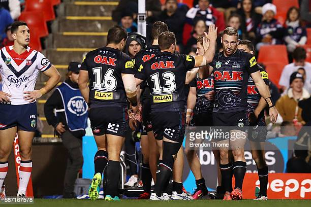 Bryce Cartwright of the Panthers celebrates with team mates after scoring a try during the round 22 NRL match between the Penrith Panthers and the...