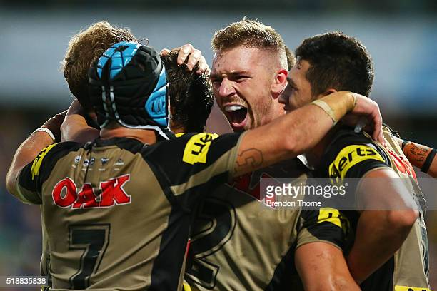 Bryce Cartwright of the Panthers celebrates with team mates after scoring the winning try during the round five NRL match between the Parramatta Eels...