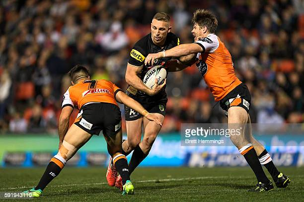 Bryce Cartwright of the Panthers is tackled during the round 24 NRL match between the Penrith Panthers and the Wests Tigers at Pepper Stadium on...