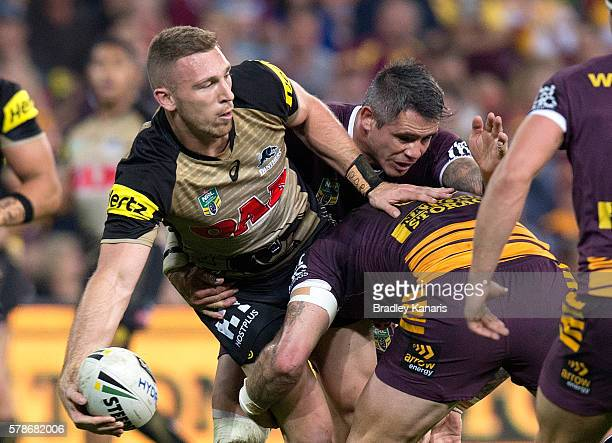 Bryce Cartwright of the Panthers looks to pass during the round 20 NRL match between the Brisbane Broncos and the Penrith Panthers at Suncorp Stadium...
