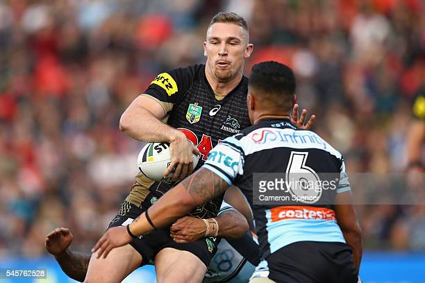 Bryce Cartwright of the Panthers offloads the ball in a tackle during the round 18 NRL match between the Penrith Panthers and the Cronulla Sharks at...
