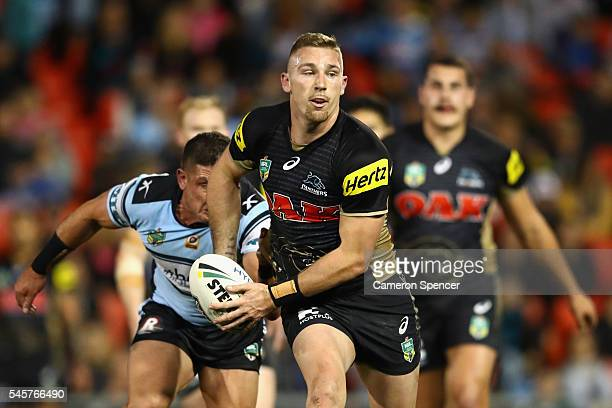 Bryce Cartwright of the Panthers runs the ball during the round 18 NRL match between the Penrith Panthers and the Cronulla Sharks at Pepper Stadium...