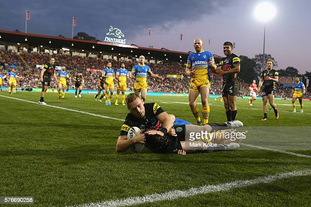 Bryce Cartwright of the Panthers scores a try during the round 19 NRL match between the Penrith Panthers and the Parramatta Eels at Pepper Stadium on...
