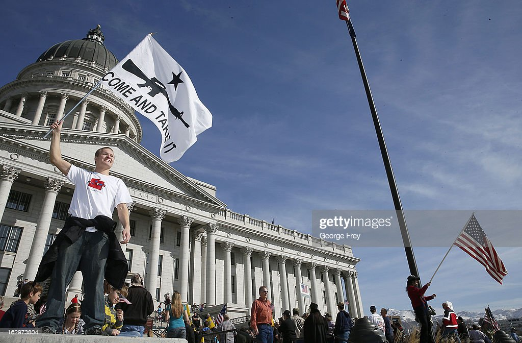 Bryce Christensen waves a gun rights flag at a gun rights rally and march at the Utah State Capitol on March 2, 2013 in Salt Lake City, Utah. The rally attracted several hundred people for the march to the Utah Capitol in favor of 2nd Amendment rights as gun control supporters call for more limits and bans on assault weapons.
