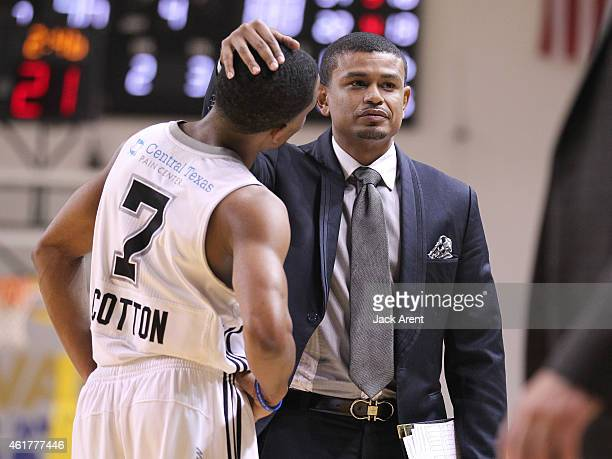 Bryce Cotton of the Austin Spurs is congradulated by coach Earl Watson while playing against the Canton Charge during the 2015 NBA DLeague Showcase...