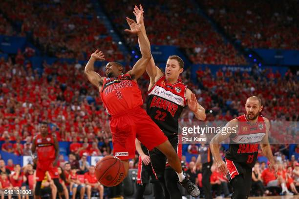 Bryce Cotton of the Wildcats gets fouled by Tim Coenraad of the Hawks during game three of the NBL Grand Final series between the Perth Wildcats and...