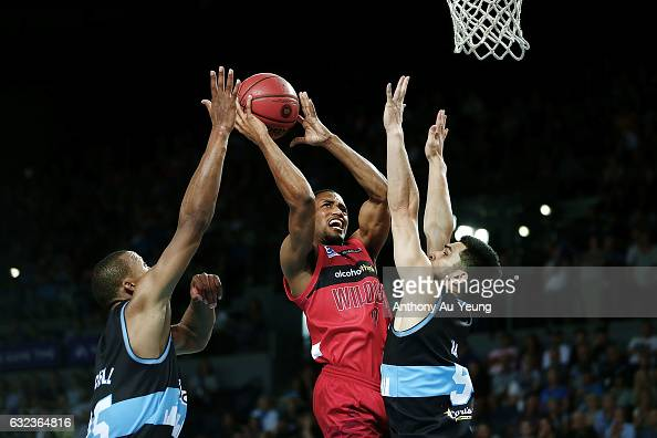 Bryce Cotton of the Wildcats goes up against Shea Ili and Akil Mitchell of the Breakers during the round 16 NBL match between the New Zealand...