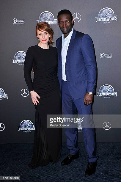 Bryce Dallas Howard and Omar Sy attend the 'Jurassic World' Photocall at UGC Normandie on May 29 2015 in Paris France