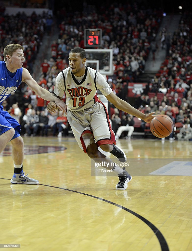 Bryce Dejean-Jones #13 of the UNLV Rebels drives against Max Yon #22 of the Air Force Falcons at the Thomas & Mack Center on January 12, 2013 in Las Vegas, Nevada.