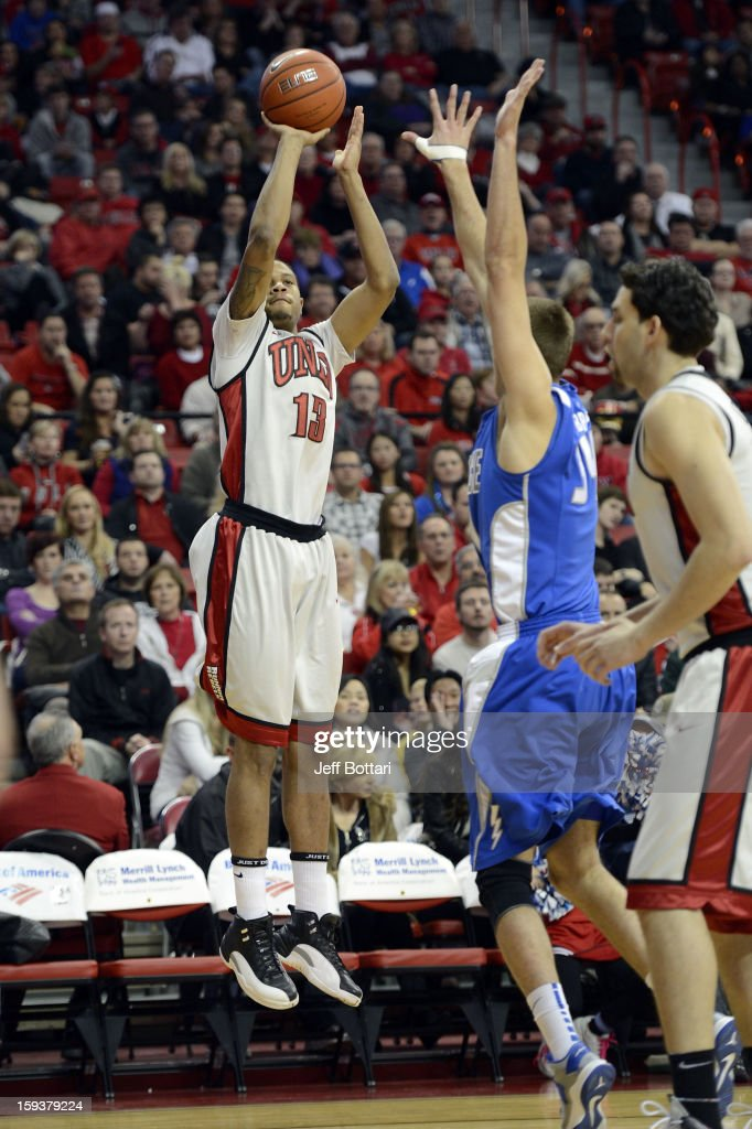 Bryce Dejean-Jones #13 of the UNLV Rebels puts up a shot against Taylor Broekhuis #34 of the Air Force Falcons at the Thomas & Mack Center on January 12, 2013 in Las Vegas, Nevada. The Rebels won 76-71.
