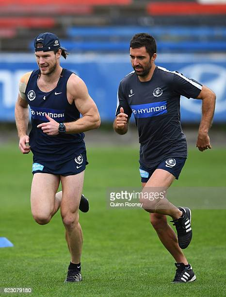 Bryce Gibbs and Kade Simpson of the Blues run during the Carlton Blues AFL preseason training session at Ikon Park on November 14 2016 in Melbourne...