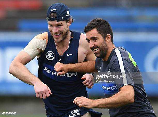 Bryce Gibbs and Kade Simpson of the Blues run whilst bumping into each other during the Carlton Blues AFL preseason training session at Ikon Park on...