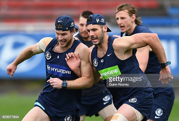 Bryce Gibbs and Simon White of the Blues run whilst bumping into each other during the Carlton Blues AFL preseason training session at Ikon Park on...