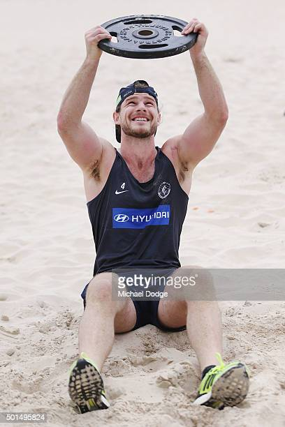 Bryce Gibbs lifts weights during a circuit training session at Kurrawa Beach during the Carlton Blues AFL preseason training camp on December 16 2015...