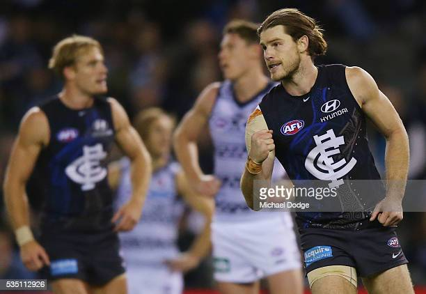 Bryce Gibbs of the Blues celebrates a goal during the round 10 AFL match between the Carlton Blues and the Geelong Cats at Etihad Stadium on May 29...